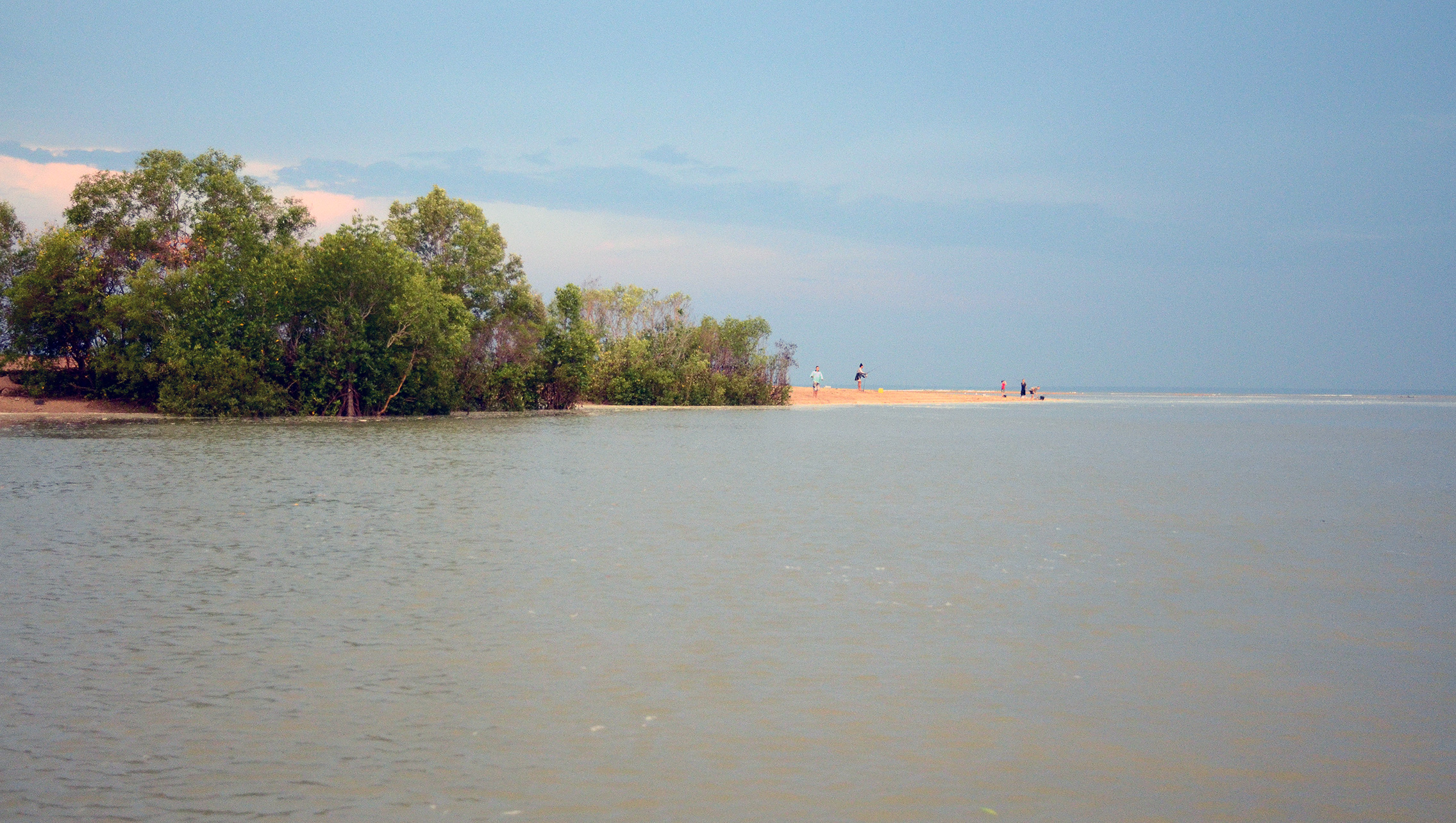 Hopeful anglers fishing from a sandspit at the mouth of Buffalo Creek on Darwin's outskirts. This would not be a smart move at night and even during the day, you need your wits about you!