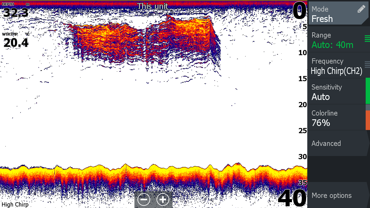 A classic sonar image taken in 32 metres of water showing a large and tightly-packed school of slimy mackerel, yellowtial and barracouta stretching from a couple of metres beneath the surface down to about 12 metres, potentially with some slightly larger fish or isolated school members under them. Note also what might be weed on the bottom at the far left.